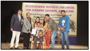 Dr. K. T. Jadhav recieving Dr. APJ Abdul Kalam Life Time Achievement National Award (International Institute for Social & Economic Reforms (R), Bangalore)