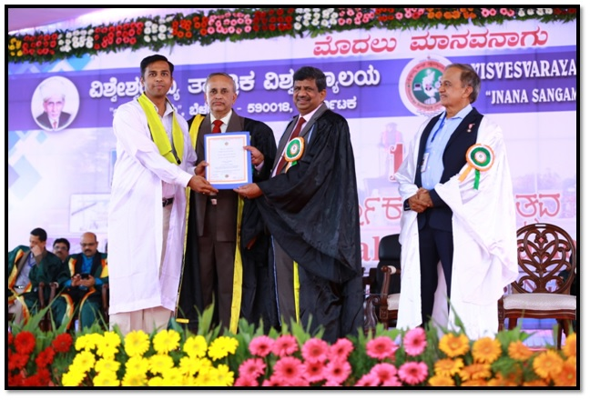 Prof. L. V. Malade receiving Ph. D degree in Chemical Engineering through hands of Hon. Dr. Karisiddappa, Vice Chancellor VTU Belagavi.