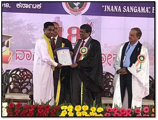 Prof. R. A. Patil receiving Ph. D degree in Chemical Engineering through hands of Hon. Dr. Karisiddappa, Vice Chancellor VTU Belagavi.